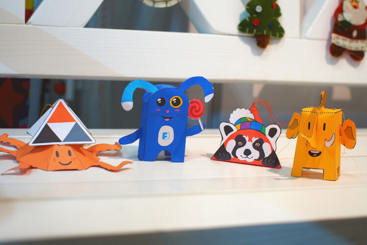 photo of four assembled paper toys